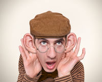Man listening with big ears. Stock Image