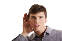 Man listening gossip. Young caucasian businessman listening gossip, isolated on white royalty free stock photos