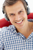 Man listening with headphones Stock Images