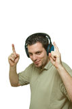 Man Listening with headphones and dancing. A man, wearing headphones, dancing to the music Stock Images