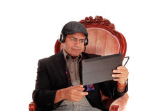 Man listening from his tablet. Stock Images