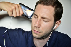 Man listening ipod Royalty Free Stock Images