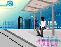Man listening music. In a bus stop Royalty Free Stock Images