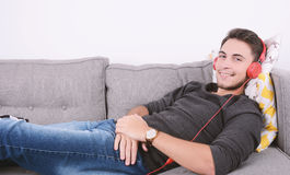 Man listening music on couch. Stock Photography