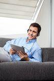 Man Listening Music On Digital Tablet Royalty Free Stock Photos