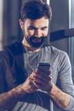 Man listening music in earphones after training. Portrait of man listening music in earphones after training Royalty Free Stock Images
