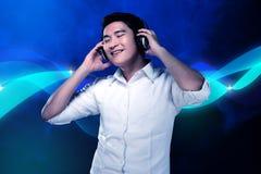 Man listening music with headphone Stock Photography