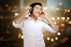 Man listening music with headphone Stock Images