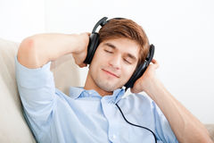 Man listening music Stock Images