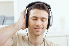 Man listening music with headphones Royalty Free Stock Image