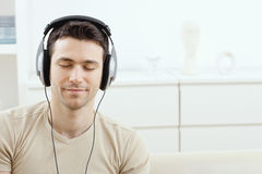 Man listening music with headphones Stock Images