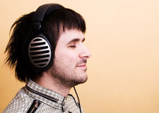 Man listening music in headphones Stock Photos