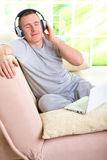Man listening music with headphones Stock Photos