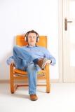 Man listening music with headphones Stock Photos