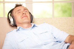 Man listening music with headphones Royalty Free Stock Images