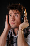 Man listening music in headphones Stock Photos