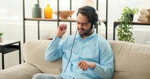 Man listening music on headphones and having fun