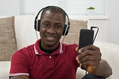 Man Listening Music On Headphones Royalty Free Stock Photos