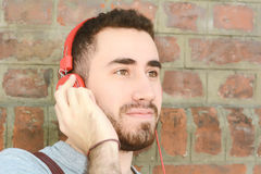 Man listening music with headphones. Stock Images