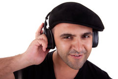Man listening music in headphones and smiling Stock Photography