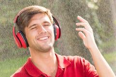 Free Man Listening Music In Rain Royalty Free Stock Image - 92476566