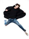 Man listening  music jumping screaming happy Stock Image