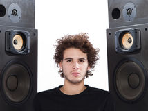 Man listening  music lover speakers. Studio portrait of a one caucasian young man listening to music lover with speakerphones isolated on white background Stock Photography