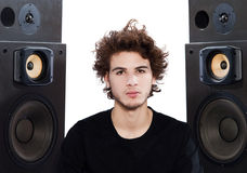 Man listening  music lover speakers. Studio portrait of a one caucasian young man listening to music lover with speakerphones isolated on white background Stock Photos