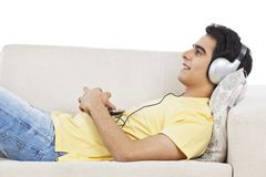 Man listening music on mp3 player Stock Photos