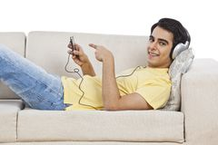 Free Man Listening Music On Mp3 Player Stock Photography - 36376112