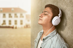 Man listening music. On outdoor Royalty Free Stock Images