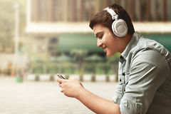 Man listening music. On outdoor Stock Images