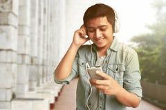 Man listening music. On outdoor Stock Photography