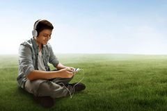 Man listening music. On outdoor Royalty Free Stock Photography