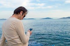 Man Listening Music on the Phone Stock Photos