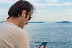 Man Listening Music on the Phone Stock Image
