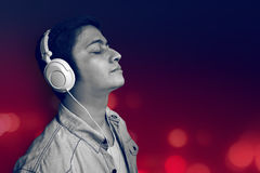 Man listening music. With simple background Royalty Free Stock Image