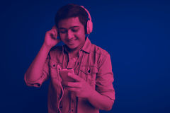 Man listening music. With simple background Royalty Free Stock Images