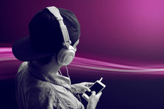 Man listening music. With simple background Stock Image