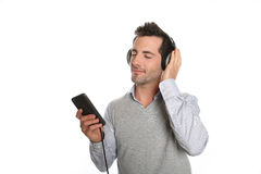 Man listening music with smartphone Stock Images