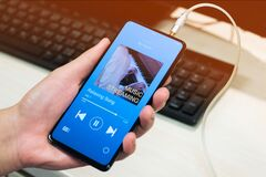 A man listening Music streaming application on smartphone