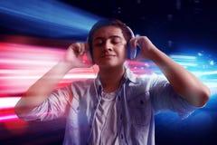 Man listening music. On the street Stock Image