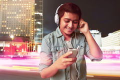 Man listening music. On the strret Royalty Free Stock Images