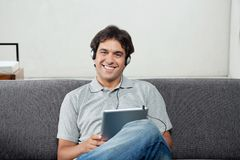 Man Listening Music On Tablet PC Royalty Free Stock Photography