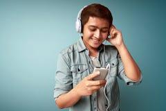 Man listening music. Wearing headphone Stock Photos