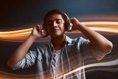 Man listening music. Wearing headphone Royalty Free Stock Photography