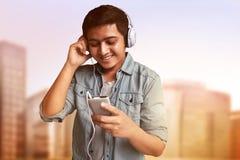 Man listening music. Wearing headphones Stock Images