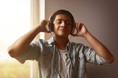 Man listening music. Wearing headphones Stock Photography