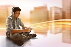 Man listening music. Wearing headphones Royalty Free Stock Photo