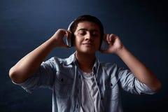 Man listening music. Wearing headpone Royalty Free Stock Photos